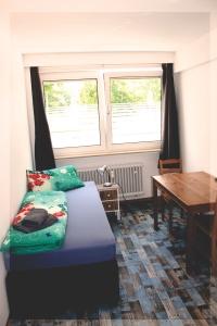 Einbettzimmer mit Waschgelegenheit.webjpg